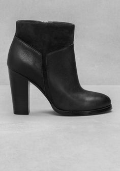 Ankle boots crafted from a slightly crinkled leather, featuring an edgy, graphic-looking pattern made from suede.