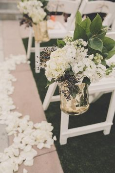 White Aisle Flowers      Photography: Gina %26 Ryan Photography     Read More:   http://www.insideweddings.com/weddings/black-white-gold-wedding-with-glitter-details-in-newport-beach/619/