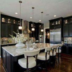 Love this kitchen!- really think u should do espresso cabinets with a white granite. Use the same espresso stain for the mantle!