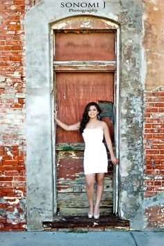She looks totally out of place here, but this old destroyed kind of building is what I'm looking for. Umm...no heels or dress for me.