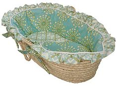 Hoohobbers baby moses basket in the burst seagrass design collection creates a sleek, stunning resting place full of wonderful bursts of very subtle, aqua-blue toned colors on turquoise.