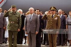 General Secretary of the Communist Party of the Soviet Union Mikhail Gorbachev (C) with Cuban President Fidel Castro (L) and Cuban Vice President Raul Castro (R) during welcome ceremony at Jose Marti International Airport. Havana, Cuba 4/2/1989