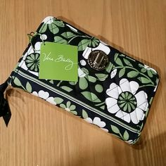 NWT Vera Bradley Lucky You Wallet New turnlock wallet.  Black green and white. Silver turnlock front, opens to 2 sections, one for cards and id's, one with 2 pockets.  Back also has a zippered compartment. Lots of places to put things.  8x5.  Tag still attached.  Perfect condition. Great gift!  No trades. Vera Bradley Bags Wallets