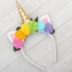 Unicorn Horn Headband with Rainbow Flowers Gold Unicorn Unicorn Horn Headband, Unicorn Ears, Rainbow Roses, Rainbow Unicorn, Unicorn Birthday Parties, Girl Birthday, Felt Crafts, Diy And Crafts, Do It Yourself Baby