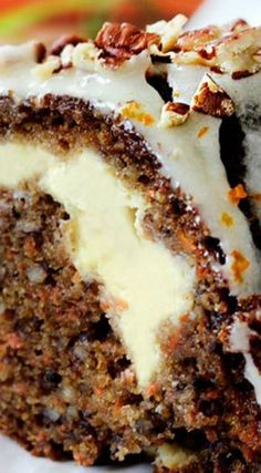 Cream Cheese Stuffed Carrot Cake with Orange Glaze ~ Super moist, spiced Carrot Cake stuffed with sweet cream cheese filling and drizzled with sweet and tangy Orange Cream Cheese Glaze that will have you drinking it straight from the bowl.