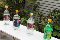 Fill bottles with water, put ping pong balls on top- have kids squirt them off with squirt guns