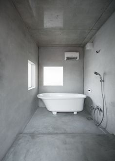 concrete bathroom by suppose design
