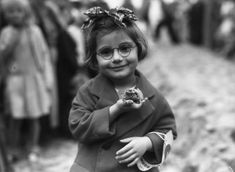 A young girl with her pet toad. 1936.