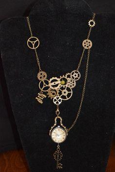 Collier steampunk / montre boule / clef maille bronze : Collier par larouedesfay