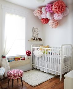 Covet Garden    fun, playful girl's nursery design with white vintage, crib, wool rug, yellow pillow, pink red fuchsia paper lanterns and pom poms and yellow pillow. Modern eclectic nursery!