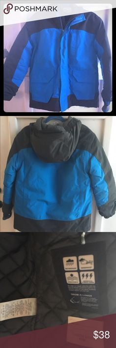 Lands End Squall parka - two tone Lands End Squall Parka. Excellent condition, smoke free pet free home. Parka features Grow Along sleeves that have not yet been extended. Reflective trim. Adjustable waist and hood. Built in hand warmers with thumb hole as shown in pictures. This is a really durable, great quality coat. My kids typically get two seasons out of these coats, as sleeves grow with child. This coat was only used sparingly for one winter. Medium 5-6. Lands' End Jackets & Coats