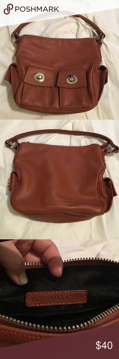 Cognac colored over-the-shoulder BCBG handbag Cognac colored BCBG handbag. Over-the-shoulder leather handbag. Bag has barely been worn and in very good condition. BCBG Bags Shoulder Bags