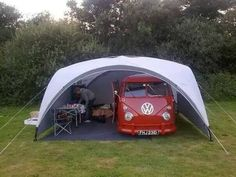 This is his perfect camping setup! What a gorgeous Bus! This is his perfect camping setup! What a gorgeous Bus! A Great idea for living with your Campervan out and about! Van Camping, Camping Glamping, Camping Hacks, Outdoor Camping, Camping Stove, Camping Setup Ideas, Camping Cabins, Camping Organization, Camping Guide