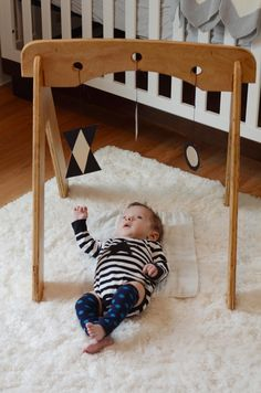 Wooden activity gym for babies.
