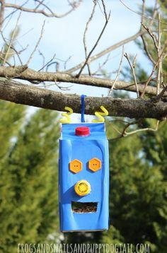 Robot Juice Carton Bird Feeder - FSPDT - love this fun kids craft! Bird Feeder Craft, Bird Feeders, Infant Activities, Preschool Activities, Recycled Crafts, Diy Crafts, Robot Crafts, Boy And Bird, Craft Projects For Kids