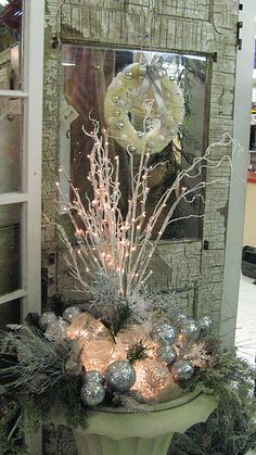 What a gorgeous way to say Welcome!  The summer flower urn re-purposed into a welcoming Christmas display
