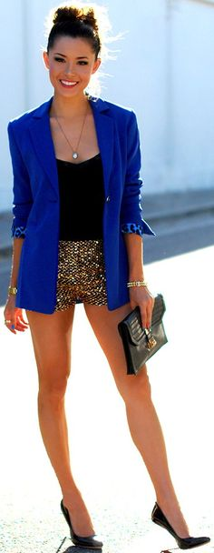 blue blazer over black top and gold sequin sparkle shorts with black heels