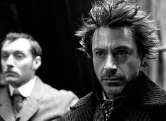 "Robert Downey Jr. as Holmes and Jude Law as Watson in ""Sherlock Holmes"" (2009)"