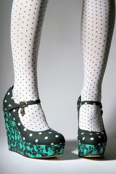 Faunarama Platform Wedge by Iron Fist Clothing for $35.75. I don't really wear these colors (and the prints used by this company are generally awful), but the polka dots are nice and I like where the strap is. Usually wedges look overly summery to me, but these are great.