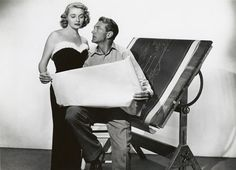 Early in her film career Patricia Neal had a notorious affair with Gary Cooper, who was married. They costarred in 1949's THE FOUNTAINHEAD, her second film.