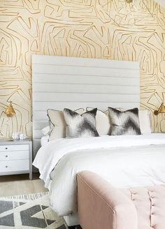 Ali Budd Interiors - Clad in Kelly Wearstler Graffito Wallpaper, this stunning contemporary bedroom boasts a tall gray tufted headboard supporting a bed dressed in gray and white bedding accented with tan velvet shams and black and white geometric pillows. SAVED BY WENDY SIMMONS