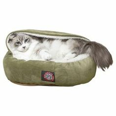 "Oversized suede pet bed with a Sherpa interior and cushioned base in sage.   Product: Pet bedConstruction Material: Suede, sherpa and polyester fiber fillColor: SageFeatures:  Made in the USA300/600 Waterproof denier base Dimensions: 16"" H x 18"" DiameterNote: Suitable for small animalsCleaning and Care: Machine wash cold and lay flat to dry"