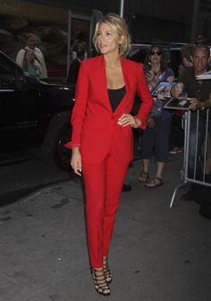 Blake Lively makes a statement in a red suit, and makes it evening appropriate with black strappy sandals.
