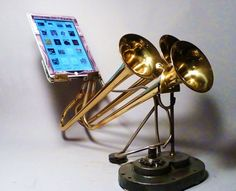 Triple Trouble - an natural amplifier to fit an iPad, made out of old trumpets, by artist Christopher Locke. cnet.com