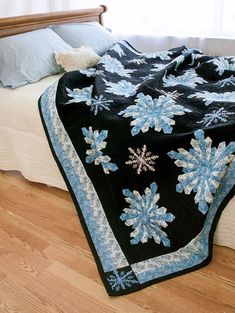Make a unique Dresden plate snowflake with wedges in 3 different sizes. Add smaller applique or embroidery snowflakes for a frosty quilt to keep you warm all winter. King: 97½