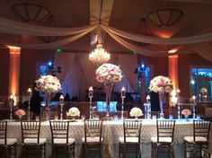 Beautiful wedding Bride and Grooms table white and pink flower arrangements