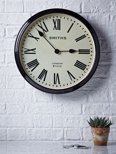 With a bold black ironwork frame, our vintage style station wall clock includes printed roman numerals set around two elegant metal hands that have a smooth and silent tick. Each large weighty clock includes a glass front and hook on reverse for hanging in your hallway or living room.