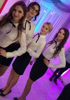 Girls Dressed In Formal Uniforms With White Shirts And Black Bows