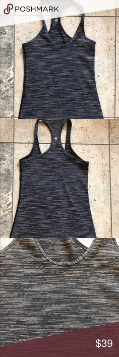 Lululemon navy striped racerback top 4 Size 4 Lululemon workout top. No cups. Navy with tan stripes. Thin stripes. Great condition. lululemon athletica Tops Tank Tops