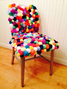 Chair covered in pom poms