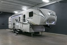 """A CLASSIC BEAUTY THAT CRAVES ADVENTURE!  2017 Jayco Eagle HT 29.5BHDS This 34' 7"""" long, 8300 lb. RV commands respect both on and off the road! Blending durability with top-quality craftsmanship, this reliable rig is ready to treat you to a lifetime of adventure. With an industry-exclusive HELIX cooling system™ you'll have a refreshing retreat after a day in the sun!  Give our Eagle HT expert Michael Coron a call 231-670-9025 for pricing and more information."""