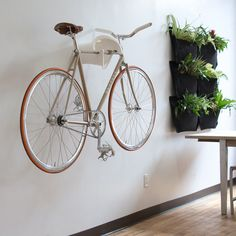 Bike storage system that curls into a tiny little wall hook!
