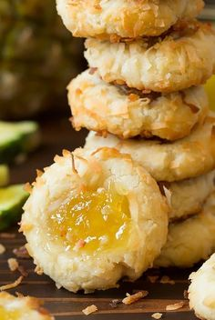 Such a delicious tropical thumbprint cookie! Buttery cookies are rolled in shredded coconut then indented and filled sweet pineapple jam. A treat you'll love year round and fun to gift during the holidays. Hawaiian Cookies, Pineapple Cookies, Pineapple Dessert Recipes, Pineapple Coconut Cookie Recipe, Candied Pineapple Recipe, Coconut Bon Bons Recipe, Pineapple Tea, Hawaiian Desserts, Coconut Recipes