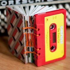 Upcycled Cassette Tape Book I have a small hoarding tendency when it comes to journals and notebooks. How fun is this one! Not to mention what a fun etsy site.