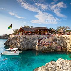 Rick's Café, Negril, Jamaica. This lively bar on Jamaica's western tip is a nonstop show—from locals performing aerial acrobatic dives from even higher cliffs, to tourists psyching up to take their own leaps from one of five rocky platforms descending from the bar's clifftop aerie (ignoring red warning signs detailing the risks). | Coastalliving.com