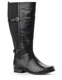 Our extra stretchy boot gives you a stylish look with complete comfort. Wide width and wide calf design offers a custom fit. Stretch fabric accents the back of the leg with two sleek buckle straps. Complete with a low heel and a full zip opening on the side. For your comfort, Catherines boots come in wide width sizes with stretchable calves to better fit the plus size woman. catherines.com