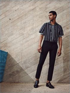 Standing tall, Tidiou M'Baye mixes vertical and horizontal stripe fashions from Zara Man.