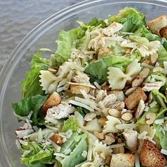 Bowtie Chicken Caesar Salad     Source: Amy Bench    Ingredients:    2 bunches green leaf lettuce, chopped  1 bag Marie Calendars Fat Free Croutons  1 bag Almond Accents/ Roasted Garlic Caesar  2 Chicken Breasts, boiled with an onion and salt and pepper  2 cups bowtie pasta, cooked  4 - 6 oz. shredded parmesan cheese  Brianna's Asiago Caesar Dressing