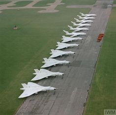 Six Avro Vulcan aircraft of No 617 squadron and six Handley Page Victor aircraft of either No 100 or No 139 Squadron (from RAF Witttering) lined up at RAF Scampton. These Vulcans and Victors are painted in their 'anti-flash' white paint-scheme. Handley Page Victor, Ww2 Aircraft, Fighter Aircraft, Aircraft Carrier, Fighter Jets, Aircraft Photos, Plane Photos, Military Jets, Military Aircraft