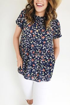 "Navy Peplum  Floral Print  Short Sleeve  Keyhole Back  Model is 5'7"" + Wearing a Small"