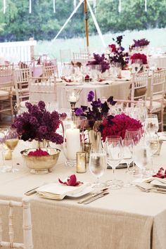 Our tables will be filled with tightly bunched purple flowers, mercury glass and pillar candles