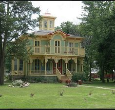 I love big front porches like this and the tower/ widow's walk at the top is beautiful too. A very colorful house as well, which I also aspire to.