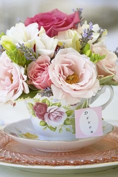 "Here's a cute idea to use as a place setting. Fill individual tea cups with fresh flowers and have a ""tea bag"" label flowing from the flowers with each guest's name on it. These precious petite arrangements can double as party favors. Just have small shopping bags ready for each guest to place their tea cup bouquet in when the party is over."
