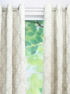 Tyler Natural Flocked Grommet Curtain Panel from The Relaxed