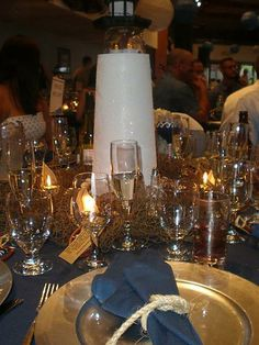 gold and silver wedding reception | Our Lighthouse Centerpiece « Weddingbee Gallery  Nautical wedding reception