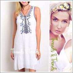 """Embroidered Embellished A Line Dress Pretty white shift dress with cobalt blue embroidery detail and drop waist ruffle hem. The perfect summer dress. Made of a flowing medium weight, crepe rayon and fully lined. Pastel Sizes S, M, L. Crochet                                                            Small Bust 34"""".                                                 Length 36"""" Med. Bust 36"""" Length 36"""" Large Bust 38"""" Length 36"""" chiffon Threads & Trends Dresses"""